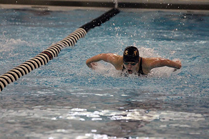 """Junior Emily Hanna swims butterfly at the EKL meet May 9. She competes in the 100 butterfly and  200 IM. """"[Butterfly] is emotionally draining when I think too much, but I feel like I'm flying when I can push all the thoughts out of my head and let my muscles work,"""" Hanna said."""
