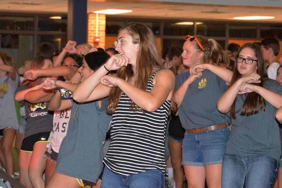 Freshman Ashley Clark dances with her friends. A DJ from Mix 93.3 provided the music.
