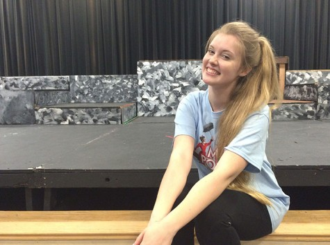 "Sophomore Maria Whitmer poses in front of the Black Box theater stage where her beginning acting class takes place. Whitmer said she can't wait to perform in all sorts of different productions. ""I like all of the people you meet,"" Whitmer said. ""And all of the great experiences you get through acting."" Photo by Marie Biernacki"