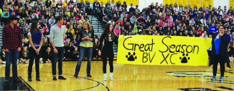 Seniors+Lauren+Sawyer+and+Serena+Nangia+present+the+cross+country+team+with+a+banner+for+their%0Aachievements+at+State.+Tiger+Pride+makes+signs+and+banners+for+activities+so+teams+know+the+school+cares%0Aabout+them.+%E2%80%9CTiger+Pride+wants+everyone+to+feel+important+to+Blue+Valley%2C%E2%80%9D+Sawyer+said.+%E2%80%9CWe+like+having+a%0Avisual+representation+of+our+support.%E2%80%9D