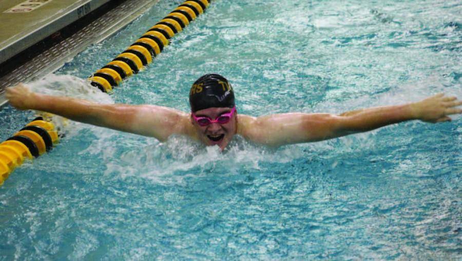 """Senior Jack Weber swims butterfly during practice. He has competed in State for the last three years. """"My favorite stroke is backstroke because that's my fastest,"""" Weber said."""