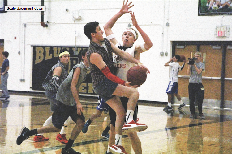 "Senior Brendan Kramer tries to pass the ball to his teammate. Hoops for Hope took place Nov. 10-11. ""I enjoyed the atmosphere and seeing people dress up in cool outfits,"" he said."