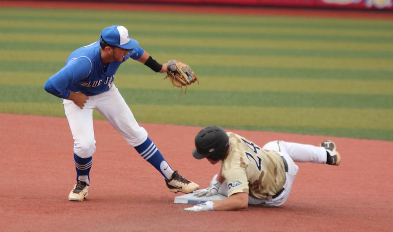 Kobe Gelles slides into 2nd base.