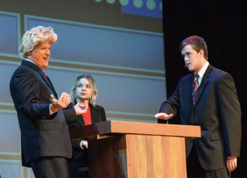 """Dressed as Donald Trump, government teacher Kristoffer Barikmo performs in Friday Night Live. FNL took place on Friday Oct. 7. """"I didn't realize that it was going to be that intense and crazy but all fun at the same time,"""" Barikmo said. """"It was amazing to see the number of students that worked so hard to put it all together."""" Photo by Melanie White."""