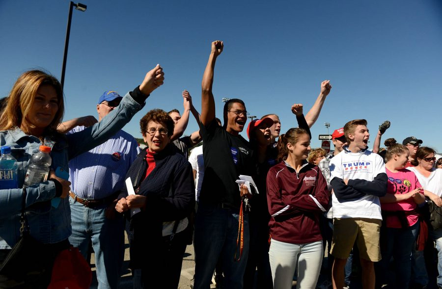 Donald Trump supporters yell at a group of pro-Hillary Clinton protesters on Monday, Oct. 10, 2016 in Ambridge, Pa. (Michael Henninger/Pittsburgh Post-Gazette/TNS)
