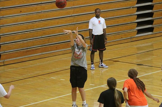 """Olivia Gurley shoots from near 3 point range. Taken during training camp, Olivia prepares for her next season. """"Since FCA is a sports-driven club, I have been influenced to be more encouraging to my teammates and that has made me an all around better person and Christian,"""" said Gurley.  Photo by Dan Gurley."""