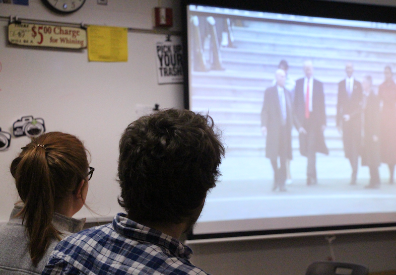 During their lunch break, two BV seniors watch President Donald Trump's Inauguration ceremony on a classroom screen.