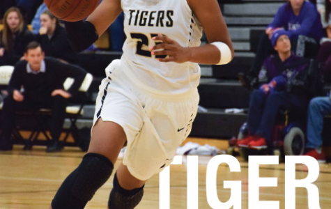 "Charging toward the basket, senior Azia Lynch dribbles down the court. The Lady Tigers lost to Blue Valley Northwest 49-45 in overtime on Jan. 5. ""The team has improved more every year and we've bonded,"" Lynch said. ""It's helped us play better."""