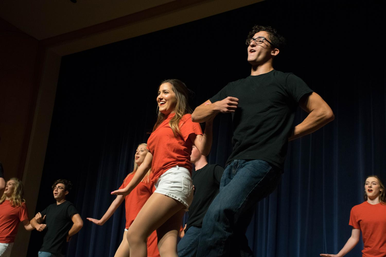 Arm in arm, seniors Tristan Rios and Noah Kahn dance in the Chamber choir's parent preview. Both the Chambers and Classy Ladies performed on Sept. 6 after just three weeks of preparation.