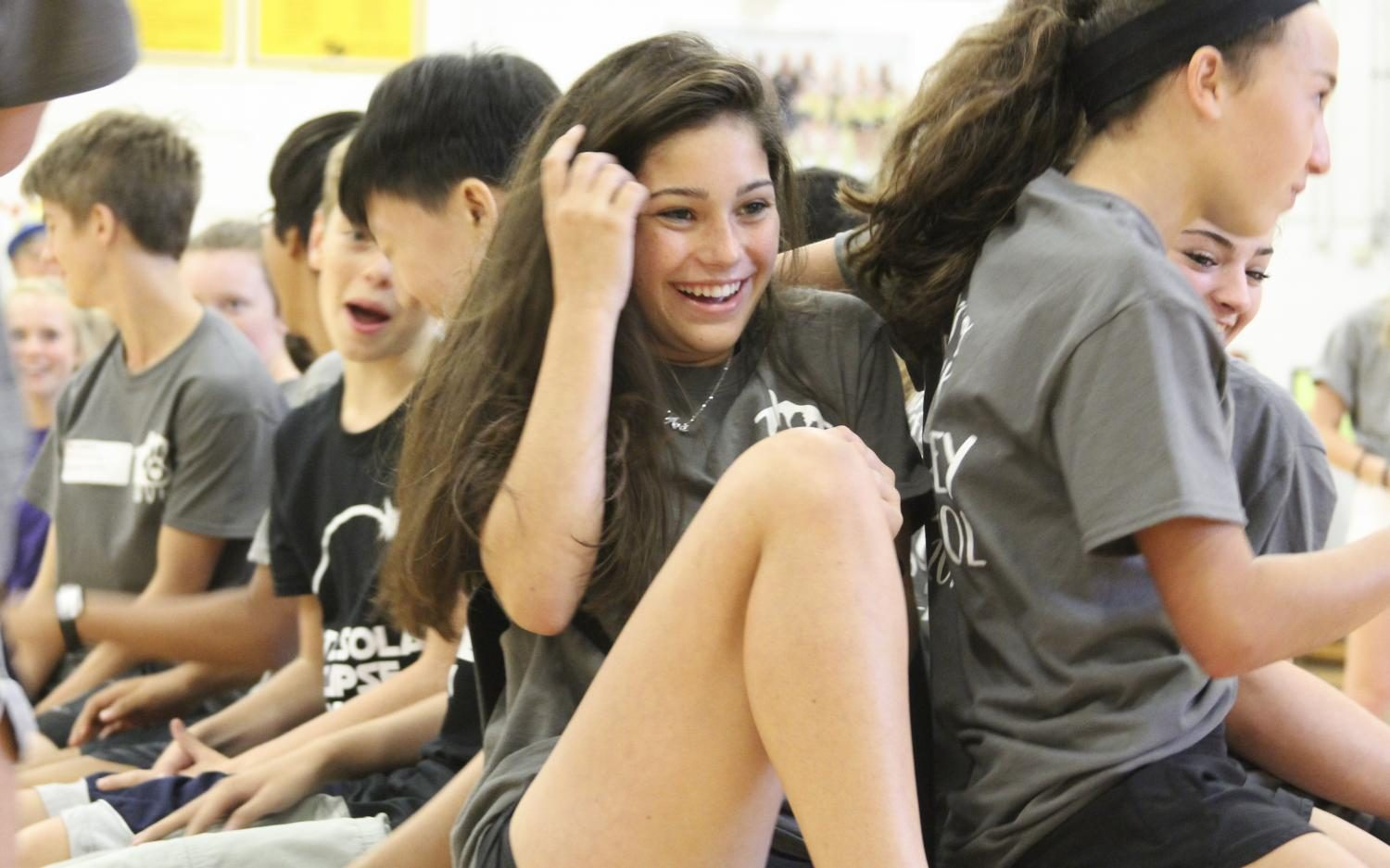 """Laughing, freshman Ava Raza plays musical chairs at the Freshman Frenzy. """"We played musical chairs and had a relay [race],"""" Raza said. """"[It] was really competitive."""""""