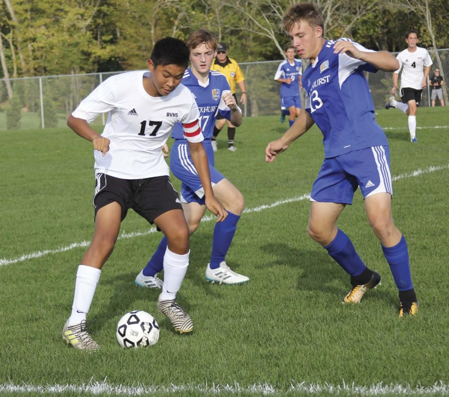 Dribbling the ball, freshman Kobee Austria attempts to out-manuever opposing players. The boy's soccer team played their last game on Oct. 19 against St. James.