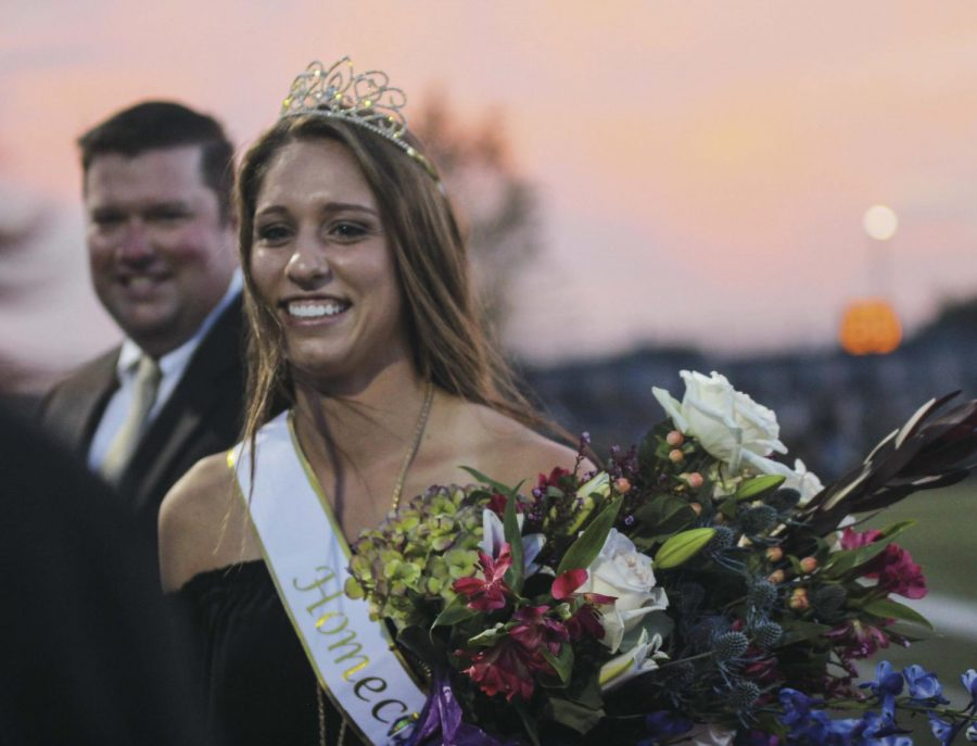 """After her crowning, Homecoming queen senior Caitlin Fitzpatrick greets her friends on the sidelines. """"It was an honor to be nominated by my peers,"""" she said. """"It says a lot about what people think [of] you."""""""