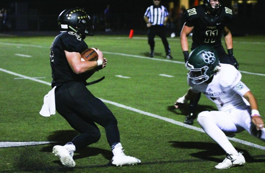 """Running the ball, junior Alex Totta attempts to make a touchdown. He said his goal in each game is """"to do what the coaches tell me to do and trust my teammates to do their job."""""""
