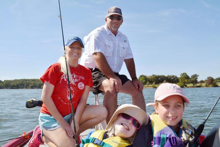 Brooke Petro (right) goes boating with a friend who is also visually impaired.