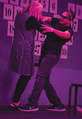 Dancing with a member of the audience, sophomore Nick Mohammadi acts in the beginning rep theater fall play. This show contained 30 short plays that were to be completed in 60 minutes.