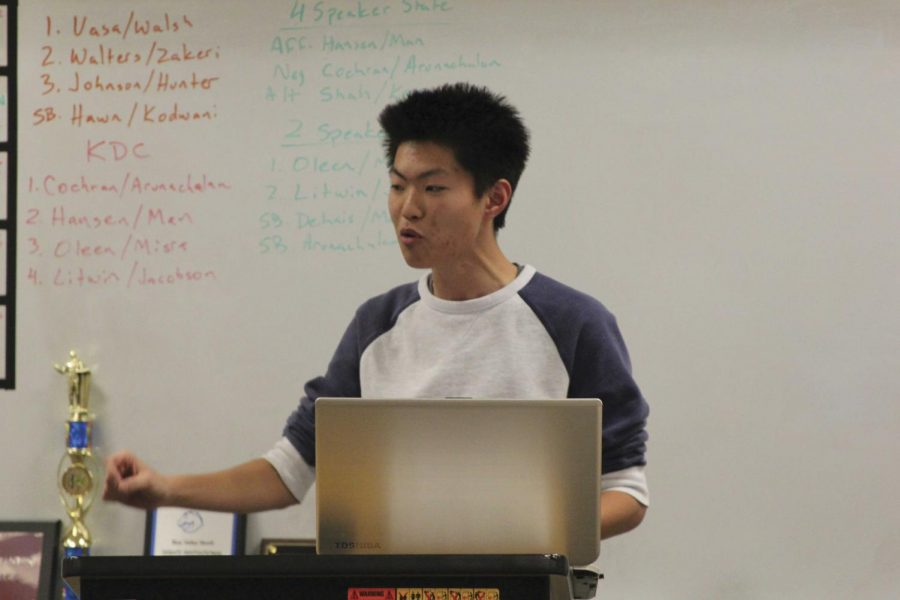 """Giving a speech, senior Kevin Man practices for the State debate competition. """"[The debate topic this year, which is] education, applies pretty well to the real world,"""" Man said. """"The policies that we talk about actually affect us."""""""