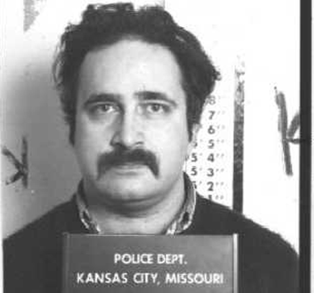 Robert Berdella, seen in this 1988 Kansas City police booking mug, was charged with multiple counts of forcible sodomy, felonious restraint and first-degree assault. Police have discovered body parts buried in the man's backyard in the midtown section of Kansas City. (Courtesy Kansas City Police Dept./Kansas City Star/MCT)