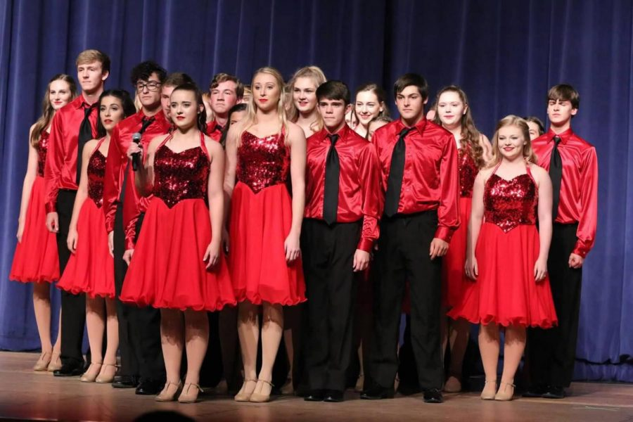 Juniors Georgia Trent (second in back row from the right) and Made Friesen (far left) perform with Chambers Singers