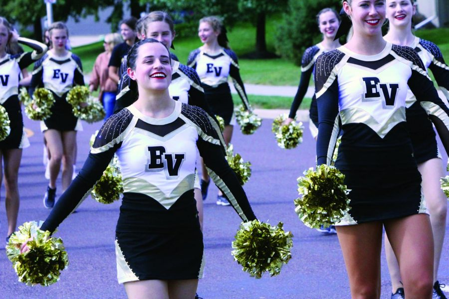 "Dancing with her team, senior Lauren O'Donnell walks in the Homecoming Parade. ""It's really a lot of work to stay super energized and perform the entire parade,"" O'Donnell said. ""Even when you're tired, you can't stop."""