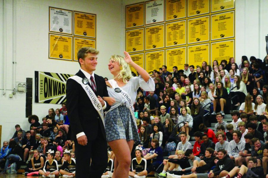 """Waving to the students, senior Allie Ament walks as a candidate for Homecoming Queen at the assembly. """"It was such an honor,"""" Ament said. """"I appreciate everyone letting me be a princess for a week."""""""