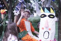 """Sitting on the freshman float, Kate O'Byran waves to the crowd. """"Ms. Fuller and Ms. Plankers came up with the idea [with me in the tiger costume],"""" O'Bryan said."""