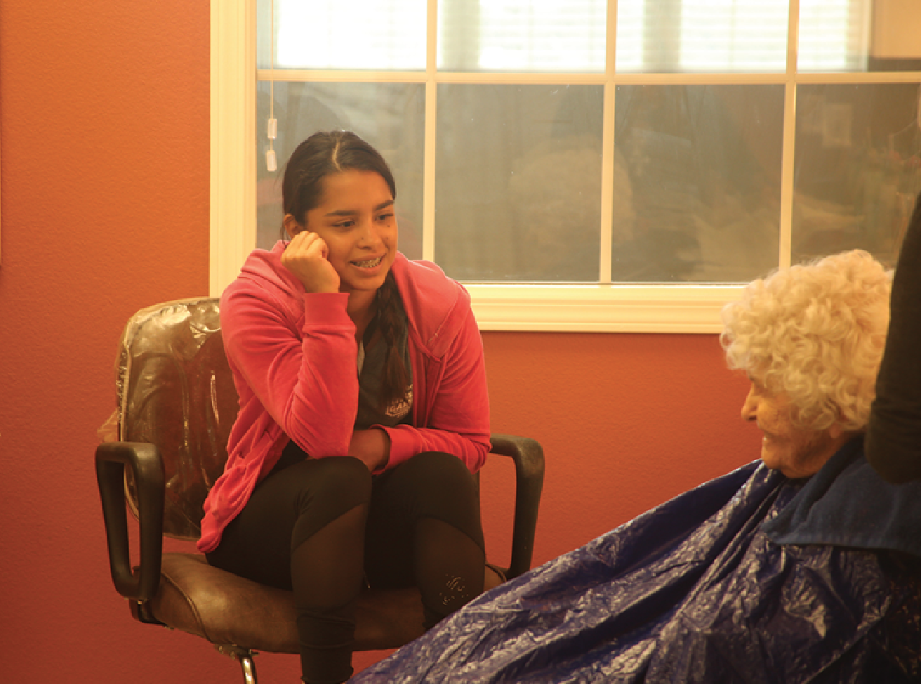 "Talking with an elderly woman at the hair salon, senior Karlis Mendoza volunteers at Vintage Park. ""The whole time was so awesome,"" Mendoza said. ""I lost my grandma a year and a half ago, so being around grandmas makes me feel closer to her."""