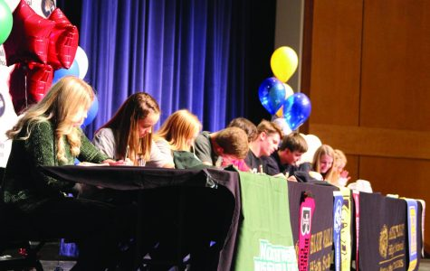 Signing their letters of intent, 10  athletes from the senior class finalize their decision to play sports after graduation.