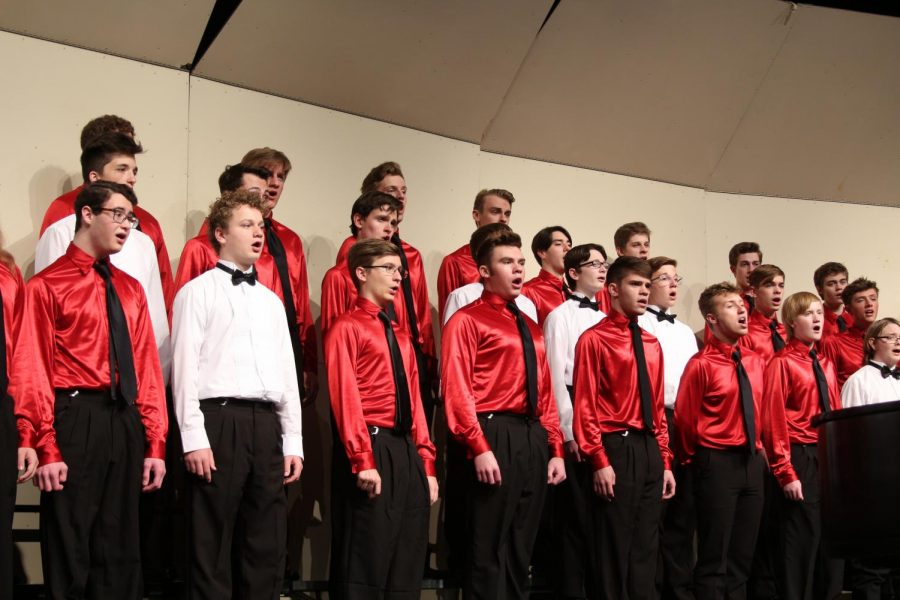 """At a concert, senior Luke Oldroyd sings. """"I have been singing since sixth grade,"""" Oldroyd said."""