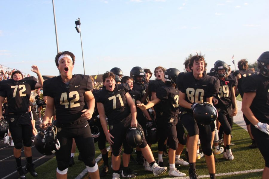 Players on the sideline go crazy after a game-winning touchdown.