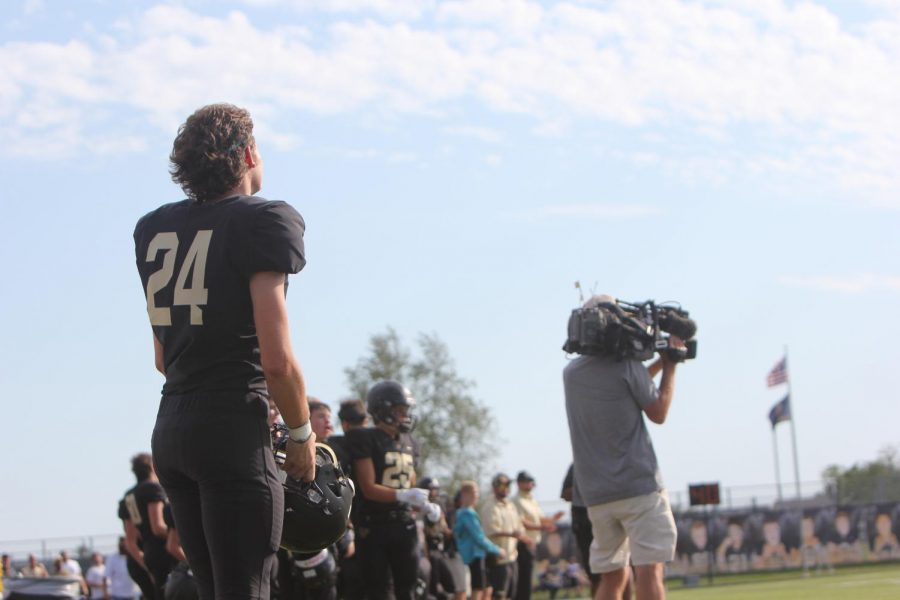 Collin Wood looks out onto the field as his teammates score the final touchdown of the game.