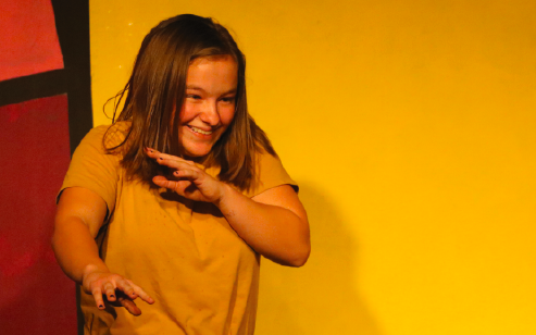 """Dodging water, sophomore Sofia Hughes performs in the Repertory Theatre class show. """"It was fun performing with my friends,"""" Hughes said."""
