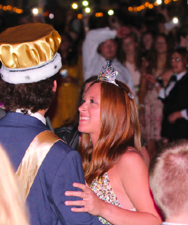 """With Homecoming king senior Colin Wood, Homecoming queen senior Evelyn Diederich dances. """"Colin is such a good guy and it makes me happy to know that my school thinks of me in that way,"""" Diederich said."""