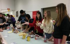 Sophomores and NFHS members Kylie Mac Ewen and Ivy Miller prepare middle schooler's crepes.
