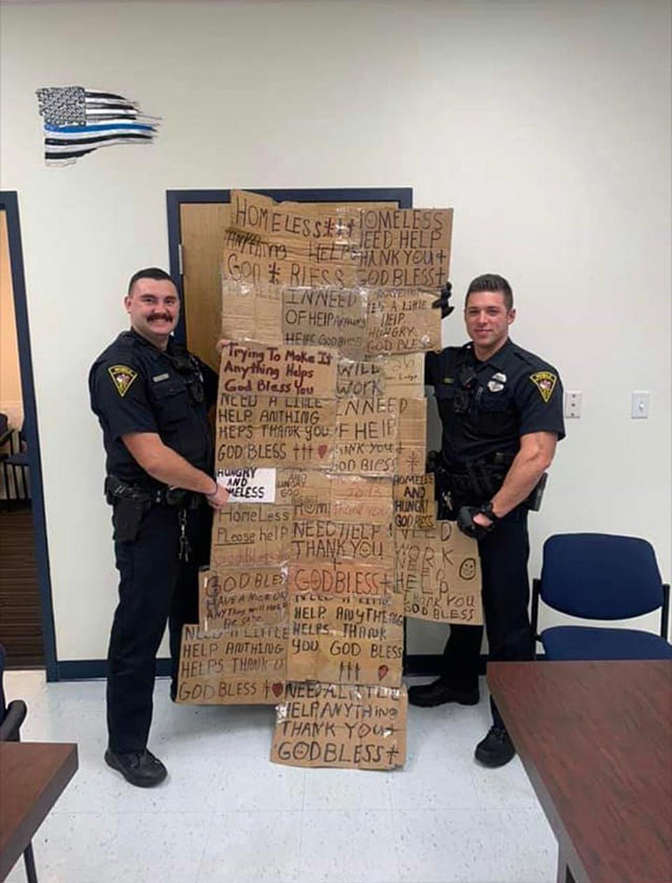 Mobile Alabama Police 'Homeless Quilt'  Alabama Cops Apologize for Posing with 'Quilt' Made of Signs Written by Homeless People  Credit: Facebook