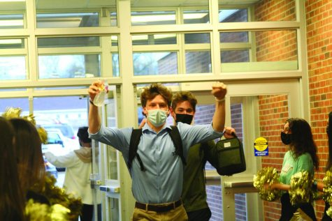 "Arriving in style, senior Tate Gillen enters BV on return day —  cheering. Although he admits the vast increase in students seemed strange at first, he believes it also brought back a greatly missed sense of normalcy. ""The freshmen and everybody deserve a good welcome back, so I think [it] was nice,"" Gillen said."