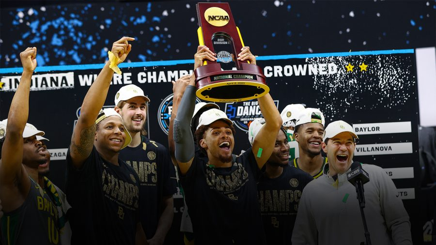 2021 Champions Baylor Bears hold the victory trophy in the midst of confetti after winning the National Championship game