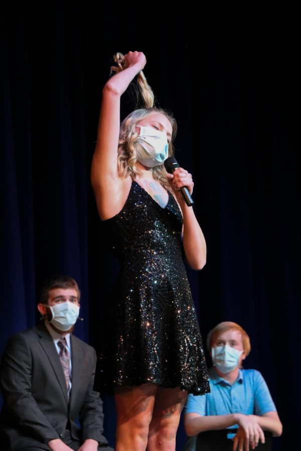 At the second annual student run cabaret, junior Hadley Way mimics the death of King George as she raps Hamilton's